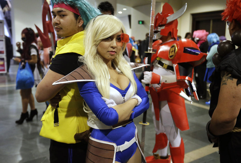 """Threa Srey, of Lowell, dressed as Bulma from the Japanese animated series """"Dragon Ball Z,"""" stands with Linda Thach, also of Lowell, in character as Vegeta from """"Dragon Ball Z"""" at the annual three-day Anime Boston in 2015. (Steven Senne/AP)"""