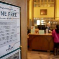 A flyer near the check-out desk explains Arlington's fine free policy. (Robin Lubbock/WBUR)