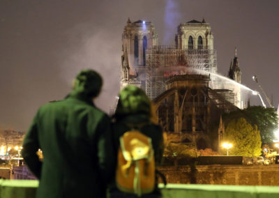 Residents look as firefighters battle to extinguish a giant fire that engulfed the Notre Dame Cathedral in Paris. (Courtesy of Maya Vidon-White)