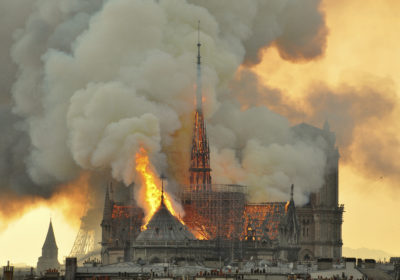 Flames and smoke rise from the blaze at Notre Dame cathedral in Paris on Monday, April 15. (Thierry Mallet/AP)