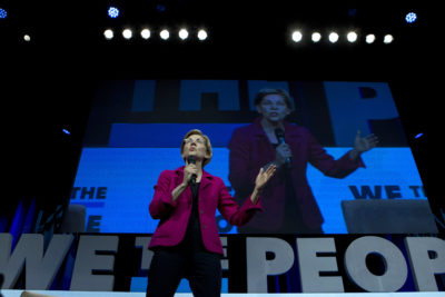 Democratic presidential candidate Sen. Elizabeth Warren, D-Mass., speaks during the We the People Membership Summit, featuring the 2020 Democratic presidential candidates, at the Warner Theater, in Washington on April 1. (Jose Luis Magana/AP)