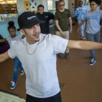 """Floor Lords Crew dancer Alex Diaz shows students a few moves during """"The Breaks"""" at Grove Hall Library. (Jesse Costa/WBUR)"""