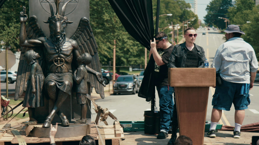 """Lucien Greaves delivering a speech in front of the state capitol building in Little Rock, Arkansas, in """"Hail Satan?"""", a Magnolia Pictures release. (Courtesy Magnolia Pictures)"""