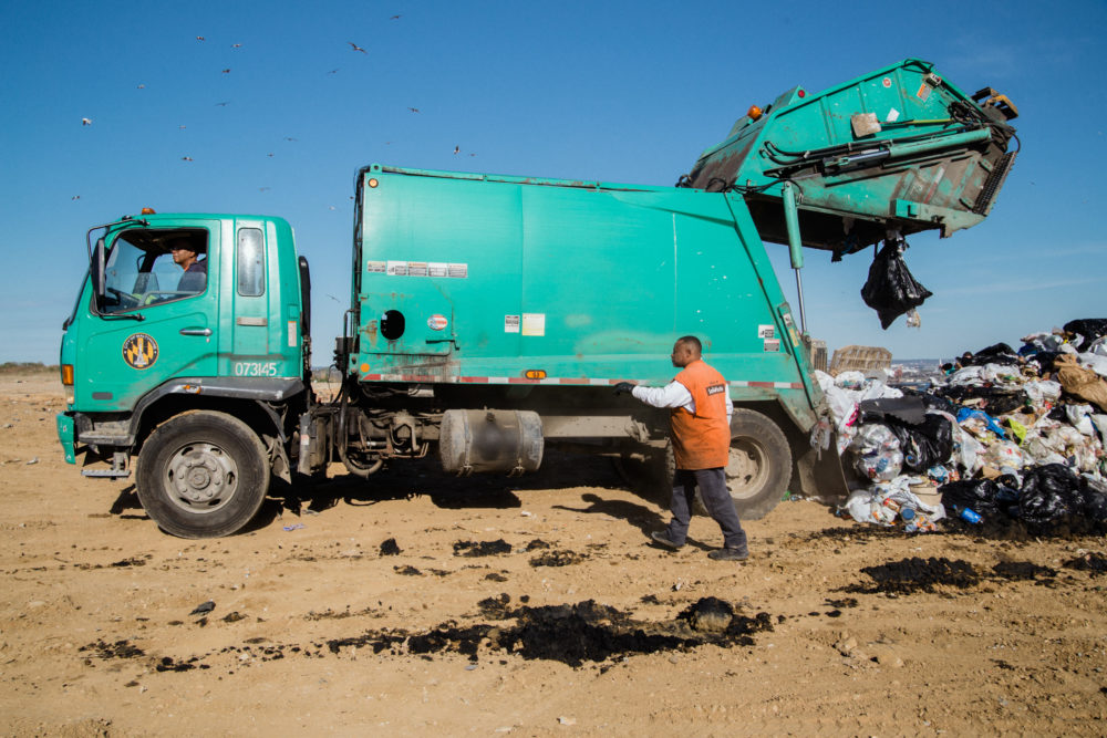 We're taking a closer look at waste — and we'd love to hear from you. Pictured: Baltimore City trash is dropped off at the Quarantine Road Landfill. (Rosem Morton for Here & Now)