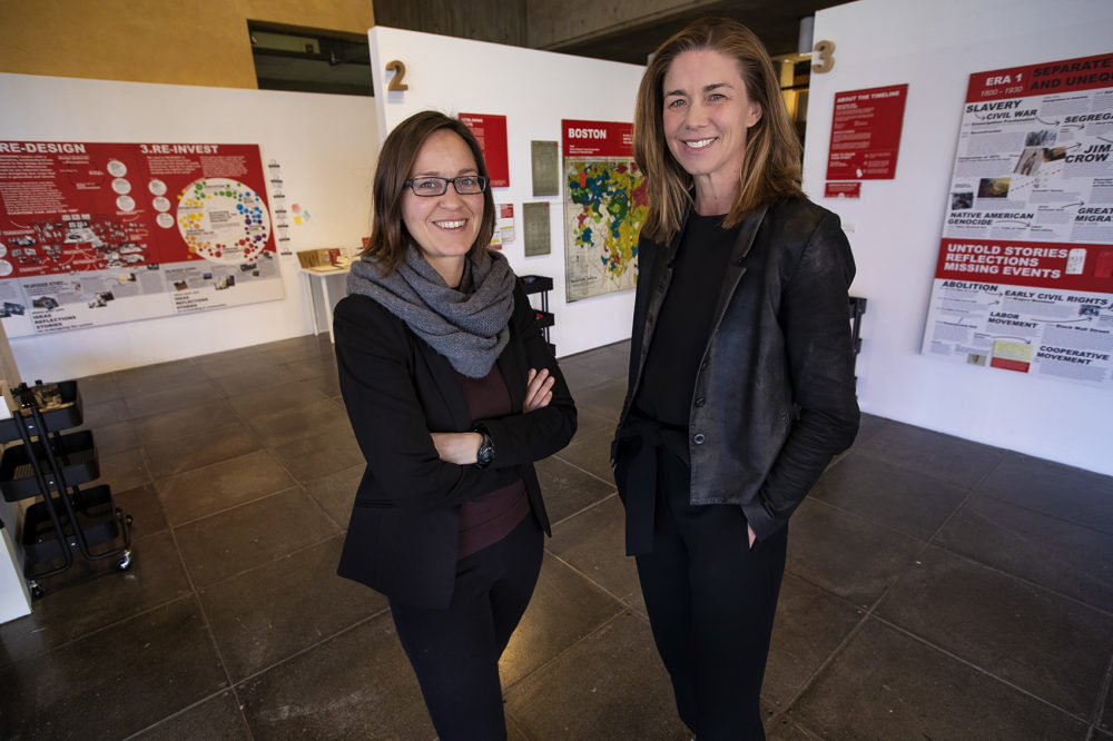 "Nella Young, left, and Katherine Swenson at the ""Undesign the Redline: the Transformation of Race, Place, and Class in America"" exhibit at the Boston Architectural College. (Jesse Costa/WBUR)"