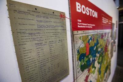"Documents and a map  show examples of redlining in Boston in the ""Undesign the Redline: the Transformation of Race, Place, and Class in America"" exhibit at the Boston Architectural College. (Jesse Costa/WBUR)"
