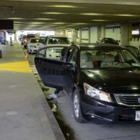 An Uber driver drops off passengers at Logan's Terminal B. (Robin Lubbock/WBUR)