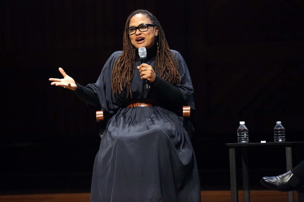 Acclaimed film director Ava DuVernay, who is also a producer and film distributor, speaks during the Friday evening program of Vision and Justice at the Sanders Theatre. (Hadley Green for WBUR)