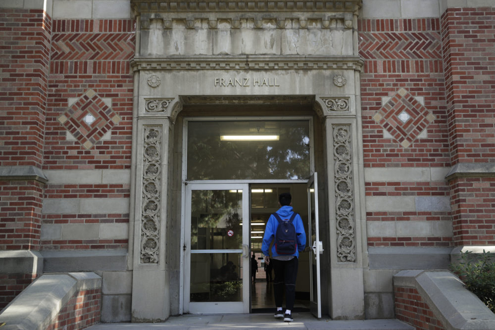 A student enters Franz Hall at University of California, Los Angeles, on April 25, 2019, in Los Angeles. Hundreds of students and staff at two Los Angeles universities, including UCLA, have been placed under quarantine because they may have been exposed to measles and either have not been vaccinated or cannot verify that they are immune. (Jae C. Hong/AP)