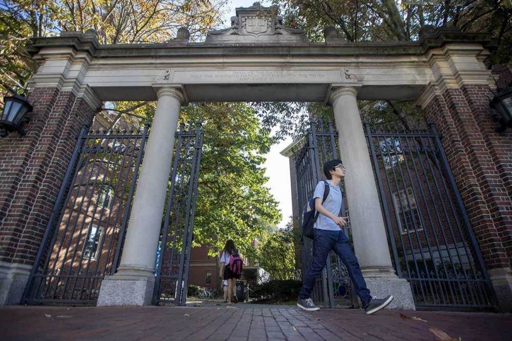 Harvard students walk through the Class of 1875 Gate in Harvard Yard. (Jesse Costa/WBUR)