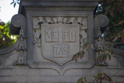 The Harvard Veritas coat of arms on one of the gates at Harvard Yard. (Jesse Costa/WBUR)