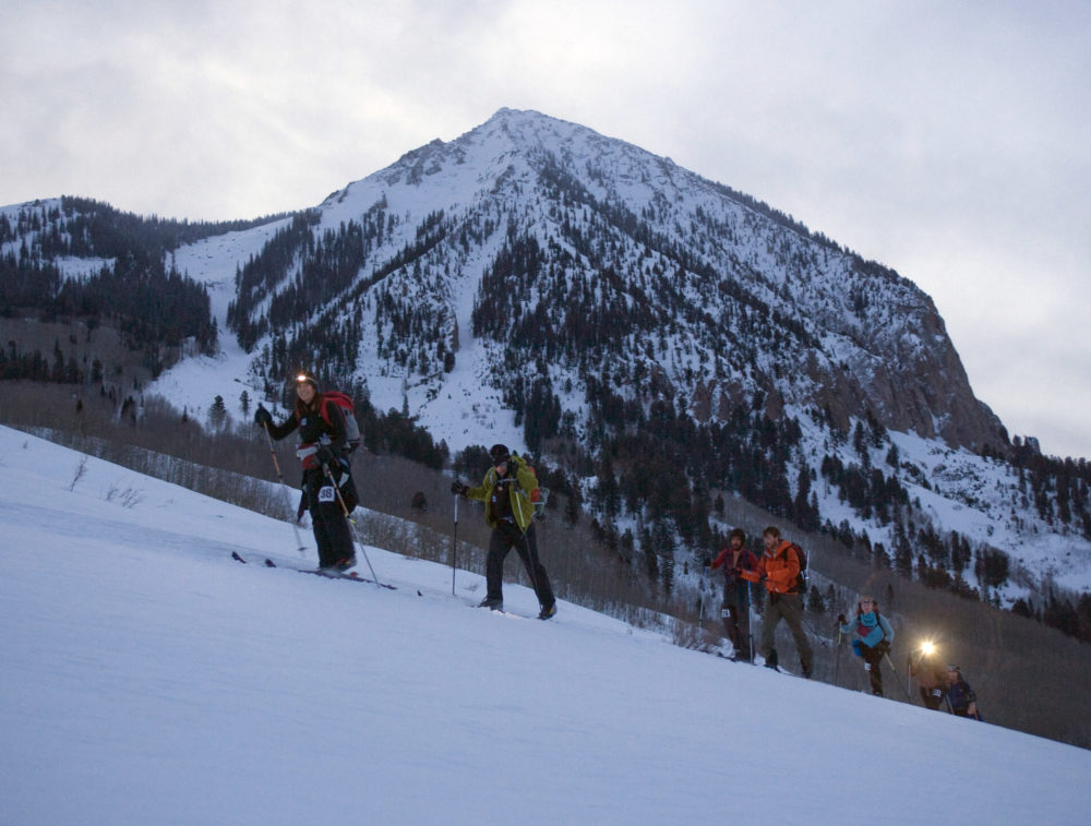 Mountaineering skiers crosses the base of Crested Butte Mountain, Colorado, at 6:30 a.m. on their way to Aspen, Colorado. (Nathan Bilow/AP)