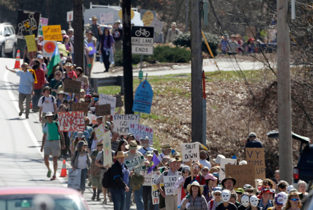 Hundreds of anti-nuclear activists march to the local offices of Vermont Yankee owner Entergy Corp. on March 22, 2012 in Brattleboro, Vermont. (Jim Cole/AP)