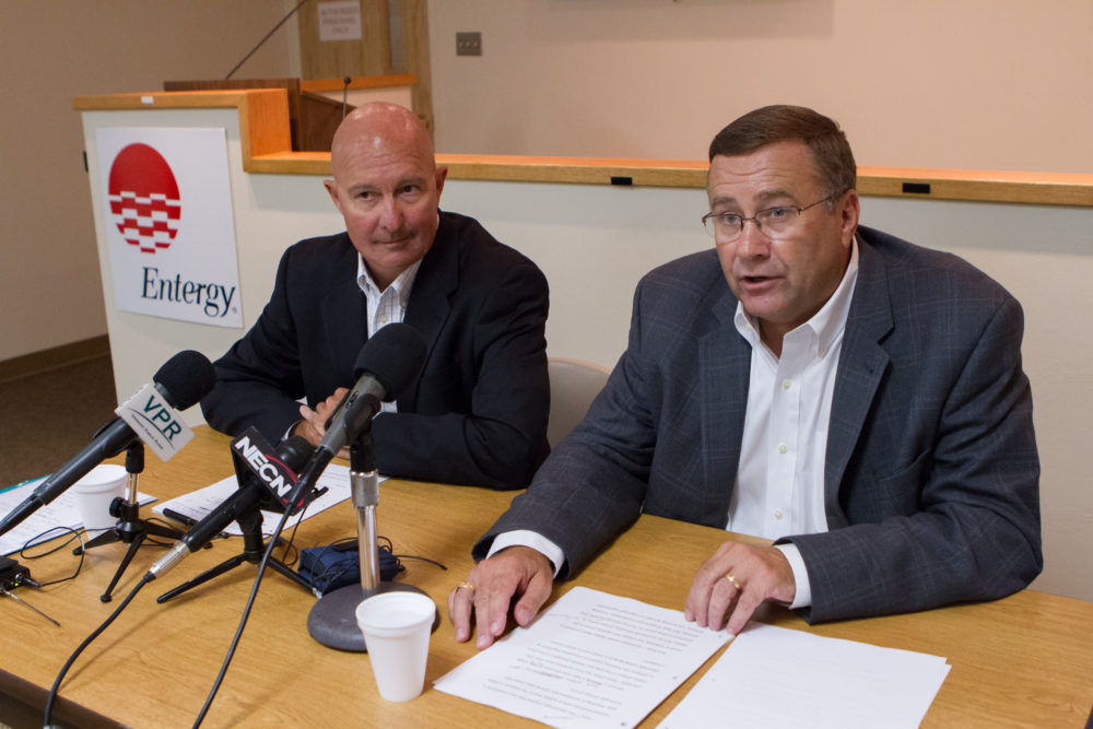 Entergy executives speak at an Aug. 27, 2013, news conference to announce the closing of Vermont Yankee. The power plant shut down in 2014. (Matthew Cavanaugh/AP)