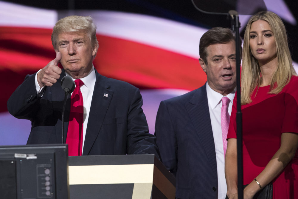 In this July 21, 2016 photo then-Trump Campaign manager Paul Manafort stands between the then-presidential candidate Donald Trump and his daughter Ivanka during a walk through at the Republican National Convention in Cleveland. (Evan Vucci/AP)