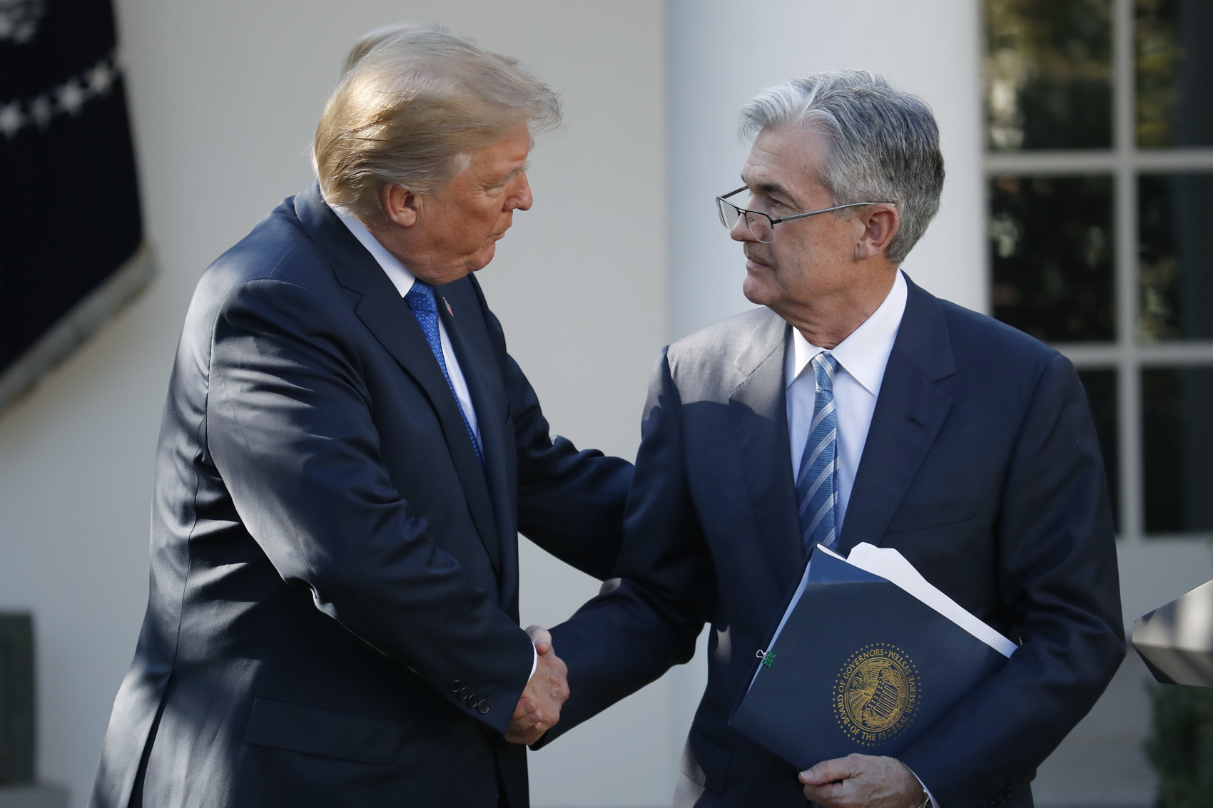 President Donald Trump shakes hands with then-Federal Reserve board member Jerome Powell after announcing him as his nominee for the next chair of the Federal Reserve, in the Rose Garden of the White House in Washington, Nov. 2, 2017. (Alex Brandon, File/AP)
