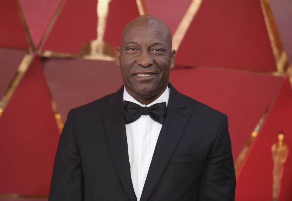 John Singleton arrives at the Oscars on Sunday, March 4, 2018, at the Dolby Theatre in Los Angeles. (Richard Shotwell/Invision/AP)