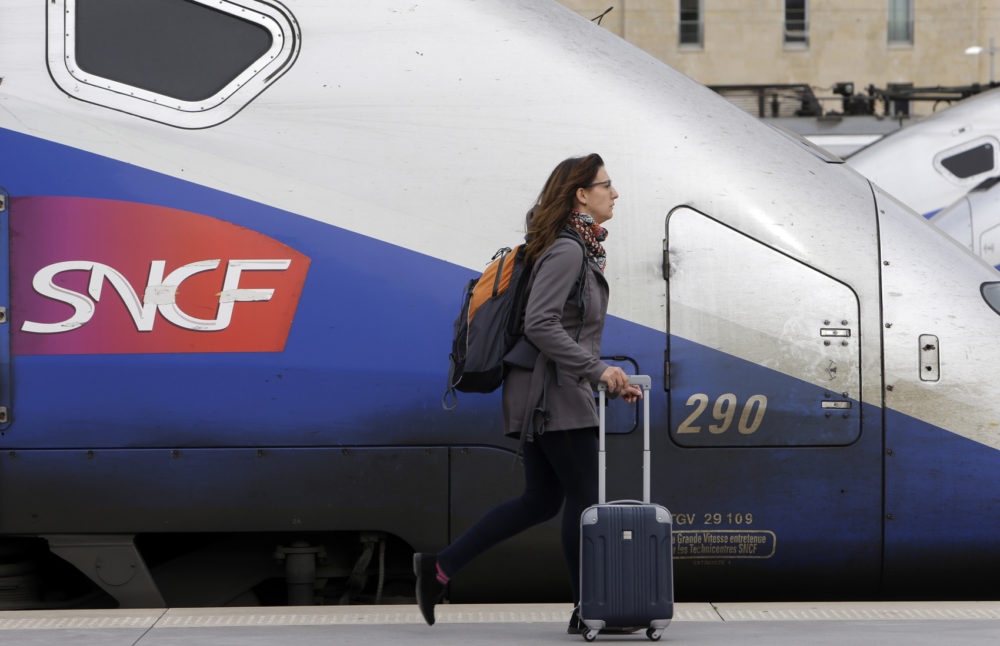 A woman walks past high-speed trains at the Saint Charles station in Marseille, southern France, Tuesday April 3, 2018. (Claude Paris/AP)