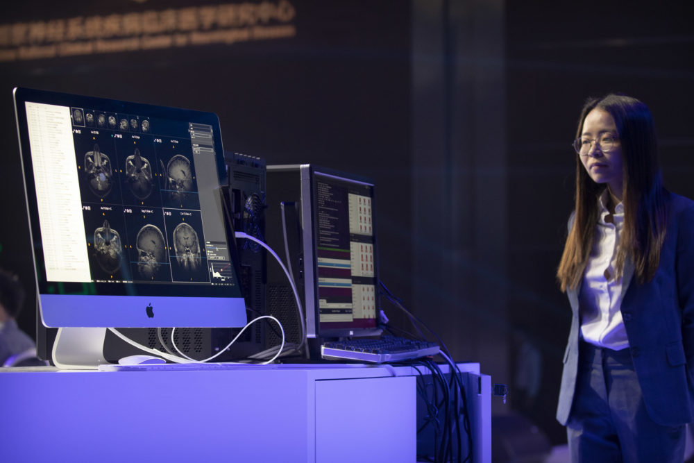 A computer running artificial intelligence software defeated two teams of human doctors in accurately recognizing maladies in magnetic resonance images during the CHAIN Cup at the China National Convention Center in Beijing in June 2018. (Mark Schiefelbein/AP)