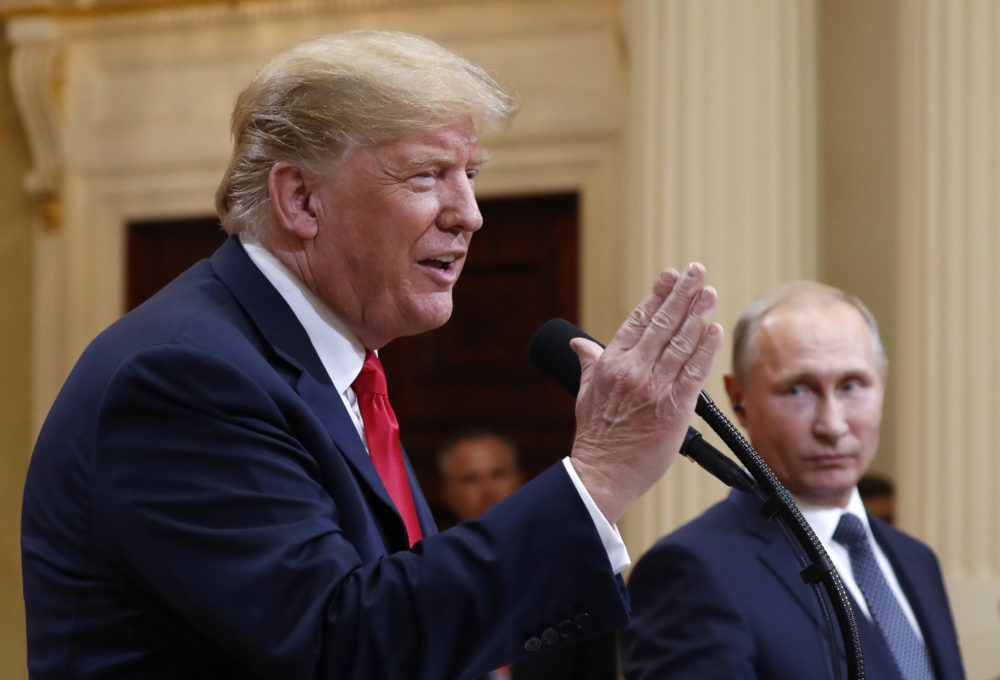 President Donald Trump speaks with Russian President Vladimir Putin during a press conference after their meeting in Helsinki, Finland, Monday, July 16, 2018. (Pablo Martinez Monsivais/AP)
