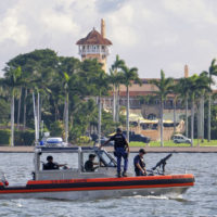 The U.S. Coast Guard patrol boat passes President Donald Trump's Mar-a-Lago estate in Palm Beach, Fla., Thursday, Nov. 22, 2018. (J. David Ake/AP)