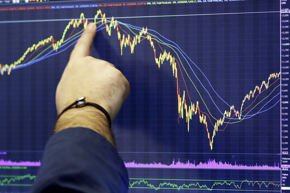 A trader follows a chart at the New York Stock Exchange. (Mark Lennihan, File/AP)