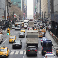 FILE- In this Jan. 11, 2018 file photo, traffic makes it's way across 42nd Street in New York City. (Mary Altaffer, File/AP)