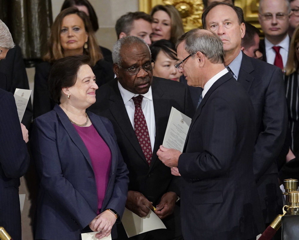 Supreme Court Chief Justice John Roberts talks with Justices Elena Kagan, Clarence Thomas and Samuel Alito at services for former President George H.W. Bush on Dec. 3, 2018. (Pablo Martinez Monsivais/AP)