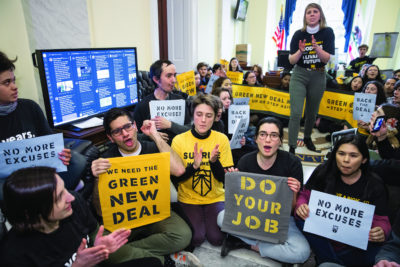 Sunrise Movement activists  occupy the office of House Democratic Leader Nancy Pelosi as they try to pressure Democratic support for a sweeping agenda to fight climate change, on Capitol Hill in Washington, Monday, Dec. 10, 2018. (AP Photo/J. Scott Applewhite)