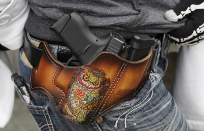 Jessica Marshall, of Roy, Wash., wears a Glock 9mm pistol in a holster at a gun-rights rally, Friday, Jan. 18, 2019 in Olympia, Wash. (Ted S. Warren/AP)