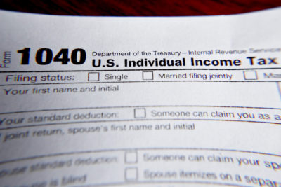 This photo made on Wednesday, Feb. 13, 2019, in Zelienople, Pa., shows 1040 tax forms printed from the Internal Revenue Service web page that are used for 2018 U.S. federal tax returns. (Keith Srakocic/AP)