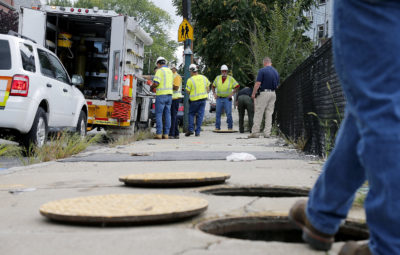 In this Sept. 14, 2018, file photo, a Columbia Gas crew works to make sure there are no gas leaks at the corner of Parker and Salem streets in Lawrence. (Mary Schwalm/AP)