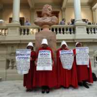 Women hold signs to protest HB 481 at the state Capitol in Atlanta on , Tuesday, April 2, 2019. (John Bazemore/AP)