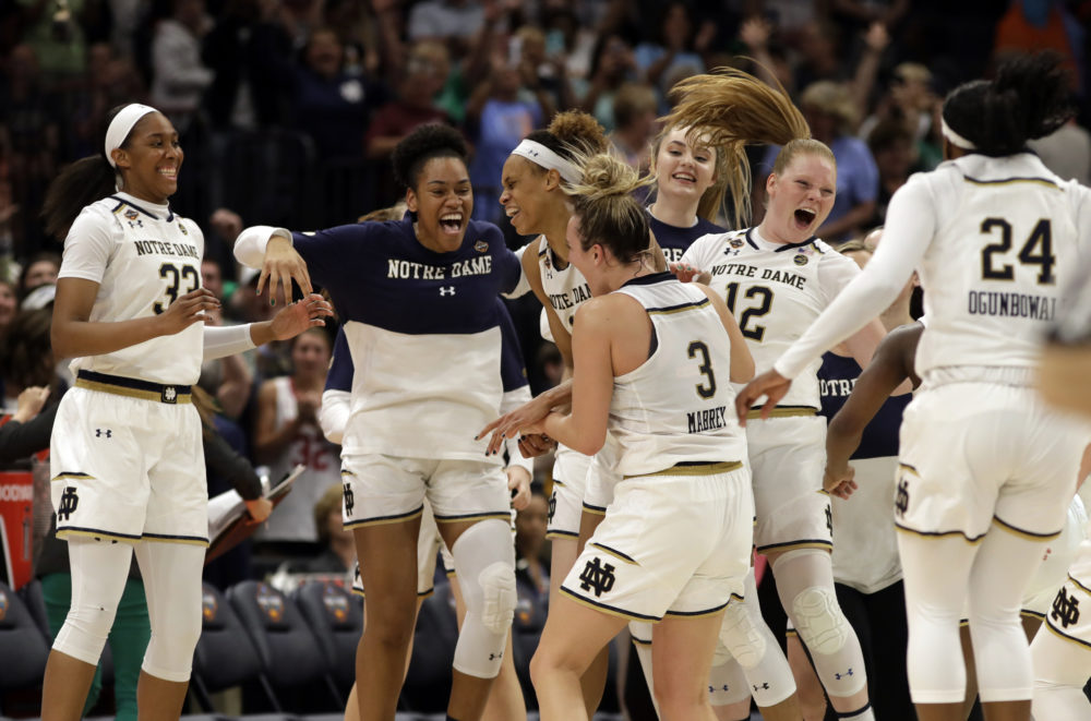 The Notre Dame team celebrate at the end of the second half of a women's Final Four NCAA college basketball semifinal tournament game against Connecticut, Friday, April 5, 2019, in Tampa, Fla. (Chris O'Meara/AP)