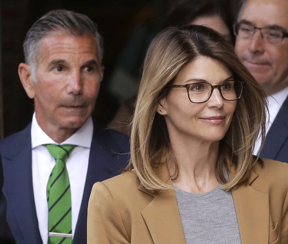 In this April 3, 2019 photo, actress Lori Loughlin, and husband, clothing designer Mossimo Giannulli, depart federal court in Boston after facing charges in a nationwide college admissions bribery scandal. (Steven Senne/AP)