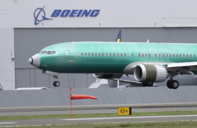 A Boeing 737 Max 8 airplane being built for India-based Jet Airways lands following a test flight, Wednesday, April 10, 2019, at Boeing Field in Seattle. (Ted S. Warren/AP)