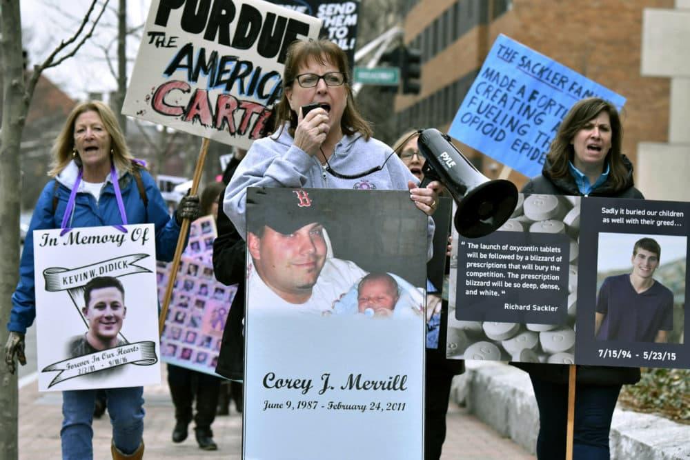 Cheryl Juaire, of Marlborough, Mass., center, leads a protest near the Arthur M. Sackler Museum at Harvard University, Friday, April 12, 2019, in Cambridge, Mass. (Josh Reynolds/AP)