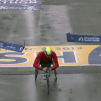 Daniel Romanchuk, of Urbana, Ill., breaks the tape to win the men's handcycle division of the 123rd Boston Marathon. (Charles Krupa/AP)