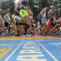 Runners cross the start line. (Stew Milne/AP)