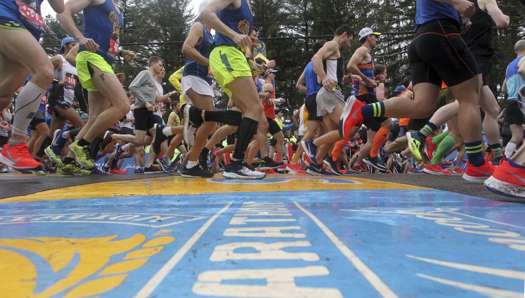 Runners cross the start line. (Stew Milne/AP)