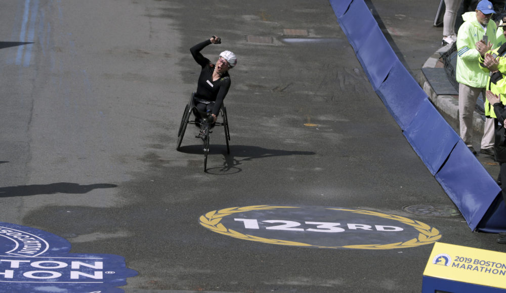 Manuela Schar, of Switzerland, celebrates as she heads to the finish line to win the women's handcycle division. (Charles Krupa/AP)
