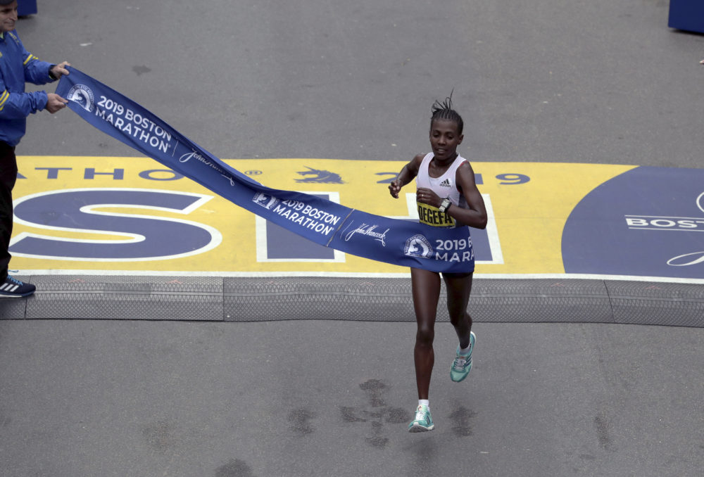 Worknesh Degefa, of Ethiopia, breaks the tape to win the women's division. (Charles Krupa/AP)