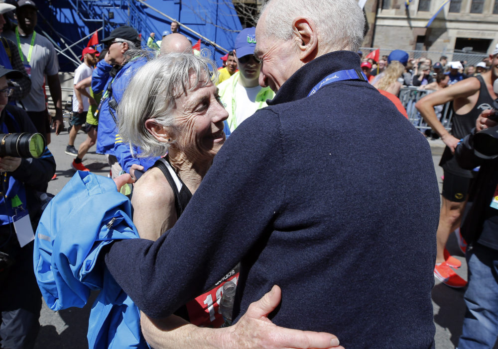 Joan Benoit Samuelson, the first women's Olympics marathon winner, is embraced after finishing the Boston Marathon on Monday -- the 40th anniversary of her first Boston victory. (Winslow Townson/AP)