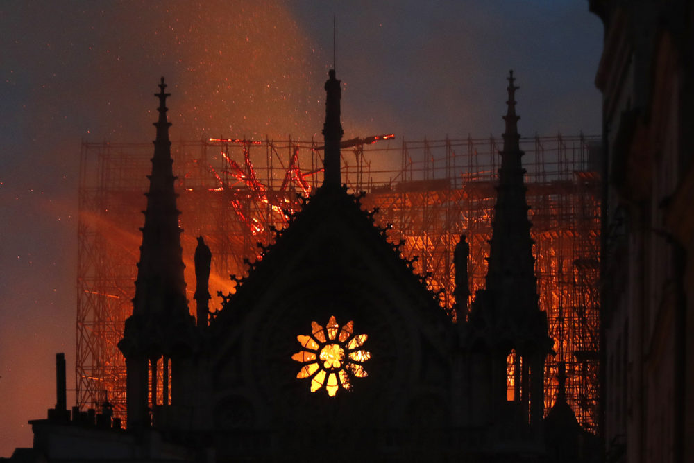 Flames and smoke rise from Notre Dame cathedral as it burns in Paris, Monday, April 15, 2019. (Thibault Camus/AP)