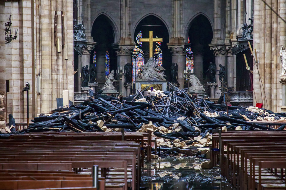 After a 12-hour battle, the flames at Notre Dame Cathedral were extinguished. Here, the debris is seen on Tuesday. (Christophe Petit Tesson, Pool via AP)