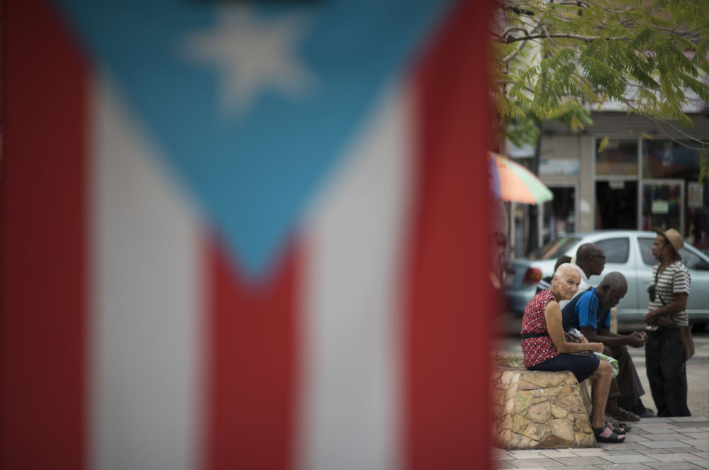 Residents sit outside the Plaza del Mercado in the Rio Piedras area of San Juan, Puerto Rico, Wednesday, April 17, 2019. (Carlos Giusti/AP)