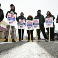 Striking workers stand on a picket line outside the Stop & Shop supermarket in Revere, Mass., Thursday, April 18, 2019. Thousands of workers remain on strike and rabbis in New England are advising their congregations not to cross the picket lines. (Michael Dwyer/AP)