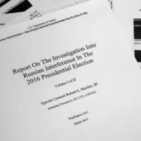 Special counsel Robert Mueller's redacted report on Russian interference in the 2016 presidential election as released on Thursday, April 18, 2019, is photographed in Washington. (Jon Elswick/AP)
