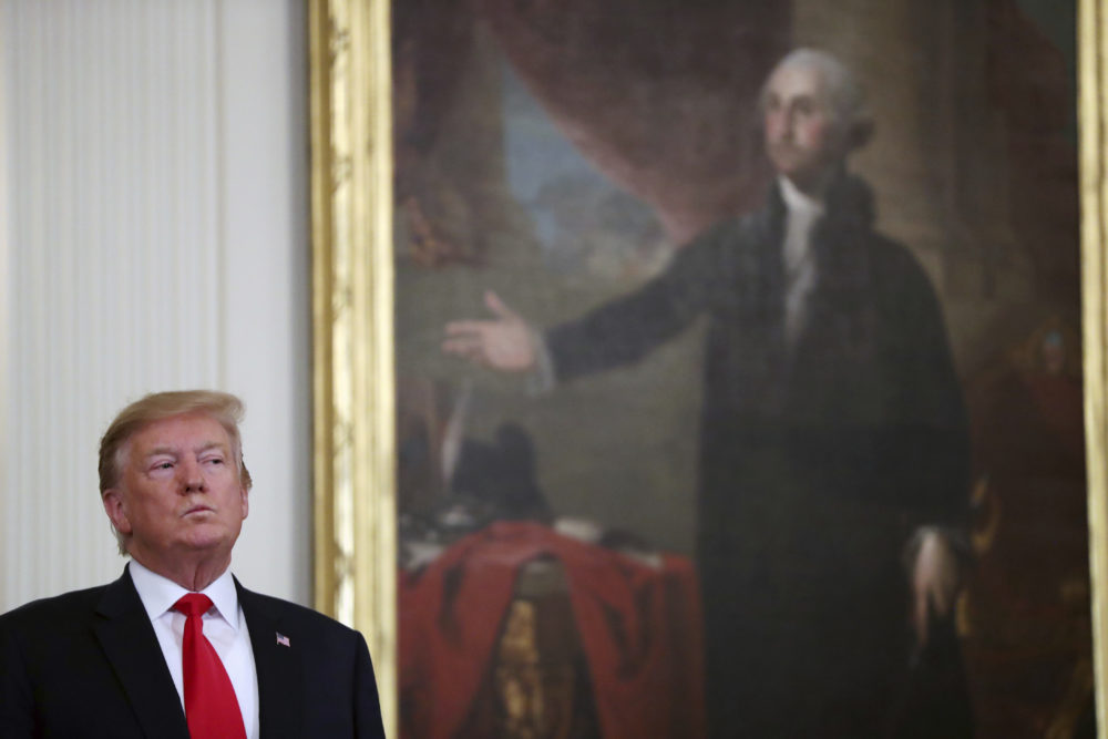 President Donald Trump stands near a portrait of George Washington at an event in the East Room of the White House on Thursday, April 18, 2019. (Andrew Harnik/AP)