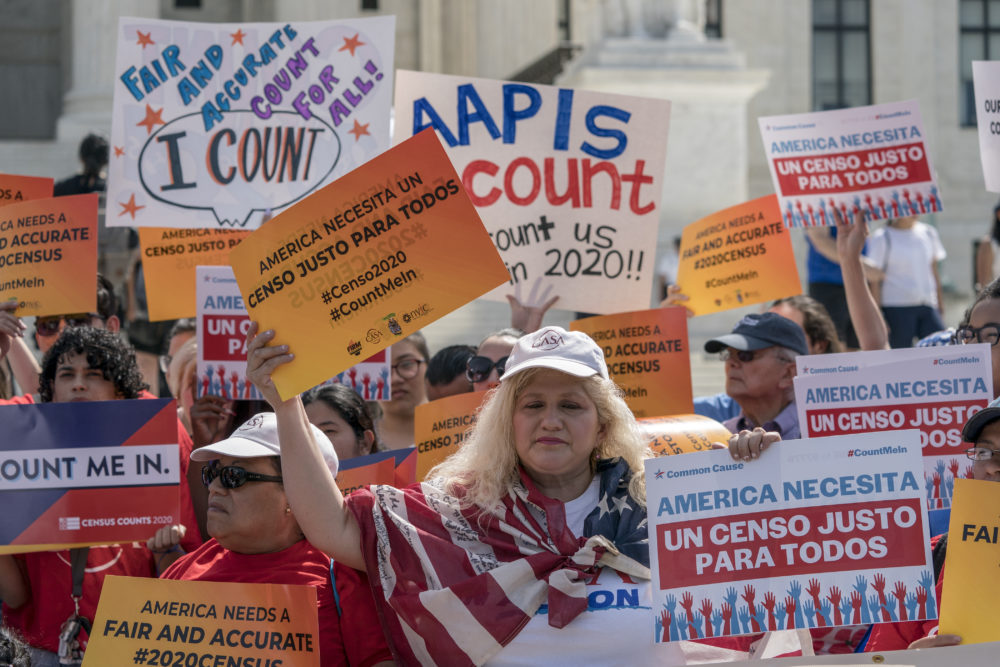 Immigration activists rally outside the Supreme Court on April 23 as the justices hear arguments over the Trump administration's plan to ask about citizenship on the 2020 census. (J. Scott Applewhite/AP)